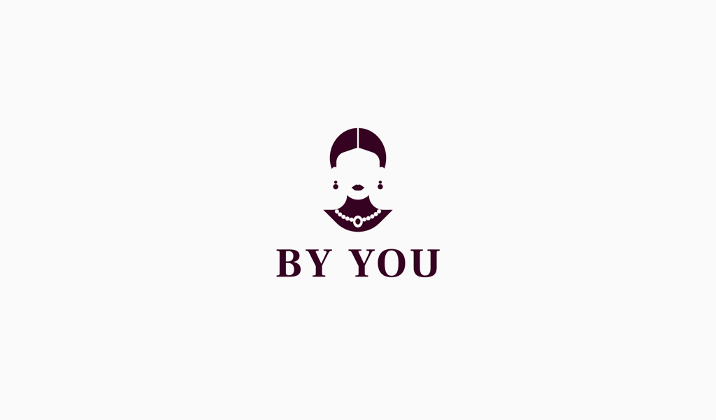 Логотип салона красоты: женщина с украшениями