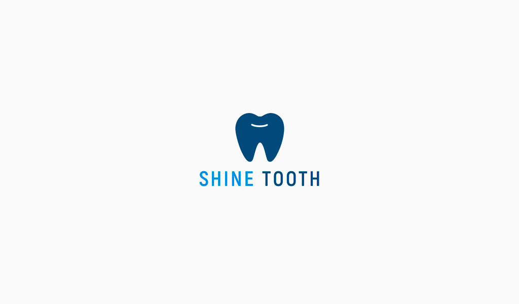 Логотип стоматологической клиники: зуб улыбка